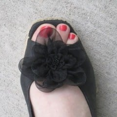shoes with flower worn