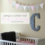 {using a curtain rod to hang a bunting}