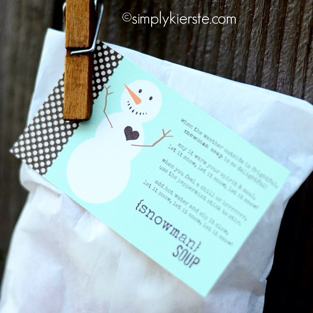 Mini candy canes, mini marshmallows, and a hot chocolate packet all packaged up + a #freeprintable = Snowman Soup! One of my most favorite #neighborgifts ever! Do a quick search and it will pop right up! simplykierste.com #simplykierste #holidaygifts #christmas