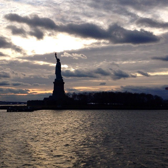 Statue of Liberty at sunset seen from Ellis Island. We were imagining what it must have felt like to arrive there for the first time after leaving everything behind for a chance at a new life. #statueofliberty #godblessamerica #christmasinnewyork