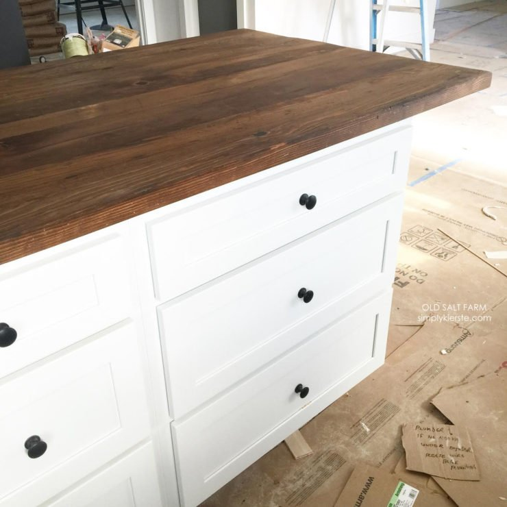 Kitchen island top made out of reclaimed barn wood | Building Old Salt Farm | simplykierste.com